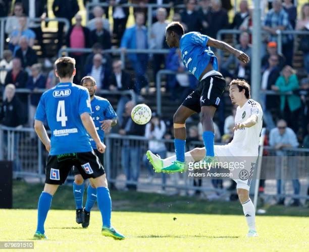 Aboubakar Keita of Halmstad BK and Stefan Ishizaki of AIK competes for the ball during the Allsvenskan match between Halmstad BK and AIK at Orjans...