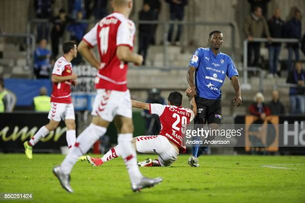 Aboubakar Keita of Halmstad BK helps Romario Pereira Sipiao of Kalmar FF to his feet at Orjans Vall on September 20 2017 in Halmstad Sweden