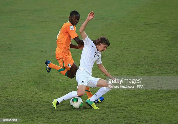 Aboubakar Keita of Ivory Coast battles with Alex Rufer of New Zealand during the FIFA U17 World Cup UAE 2013 Group B match between New Zealand and...
