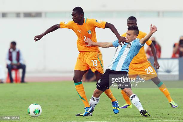Aboubakar Keita of Ivory Coast is challenged by Lucio Compagnucci of Argentina during the FIFA U17 World Cup UAE 2013 Quarter Final match between...