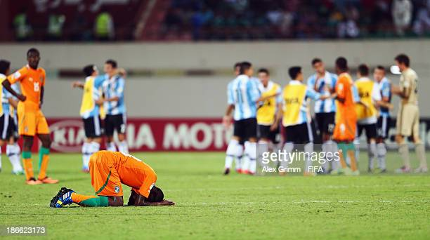 Aboubakar Keita of Ivory Coast reacts as players of Argentina celebrate after the FIFA U17 World Cup UAE 2013 Quarter Final match between Argentina...