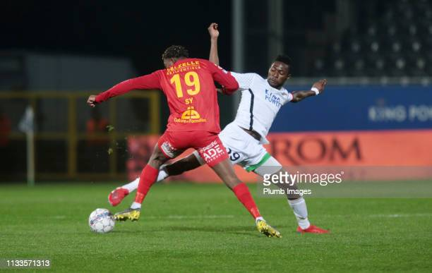 Aboubakar Keita of OH Leuven in action with Sanasi Sy of AFC Tubize during the Proximus League play down match between OH Leuven and AFC Tubize at...