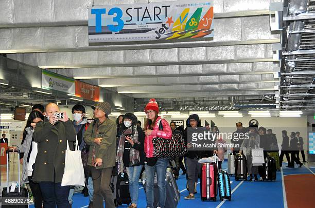 About 100 people line up in front of the departure lobby of the new terminal building at the Narita International Airport on April 8 2015 in Narita...