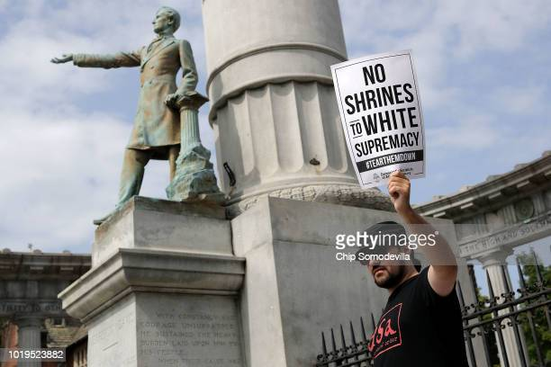 About 100 protesters gather at the Jefferson Davis Monument August 19 2018 in Richmond Virginia The protesters rallied in opposition to Confederate...