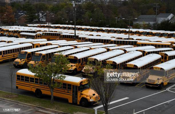 About 100 school buses are parked at the Arlington County Bus Depot in response to the novel coronavirus COVID19 outbreak on March 31 2020 in...
