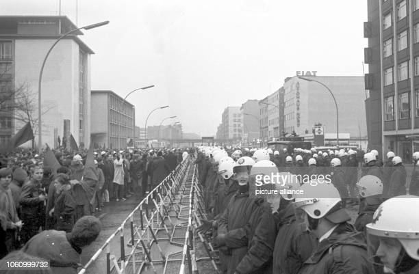 About 1000 members primarily students of the APO demonstrate against the SPD on the occassion of the 50th anniversary of Rosa Luxemburg's and Karl...