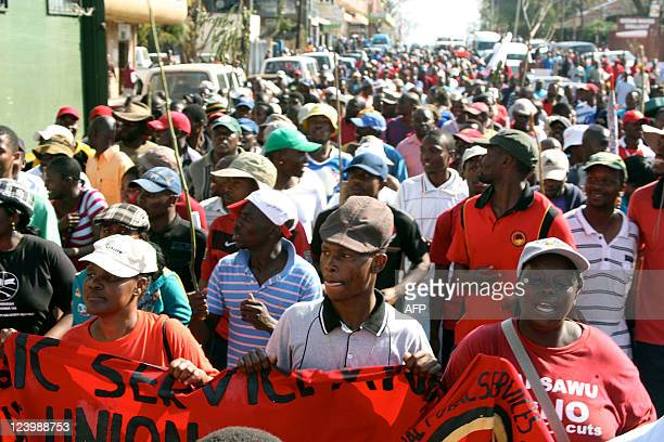 About 1,000 protesters march toward the center of Manzini, Swaziland's main city, on September 7, 2011. Protesters, brandishing sticks and branches,...