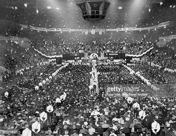 About 20000 supporters attend a Nazi rally at Madison Square Garden on the night as 1000 police keep 600 Communist protesters outside