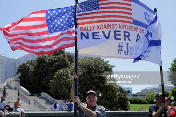 About 30 people join a rally against antisemitism and in support of President Donald Trump front of the West Front of the US Capitol May 07 2019 in...