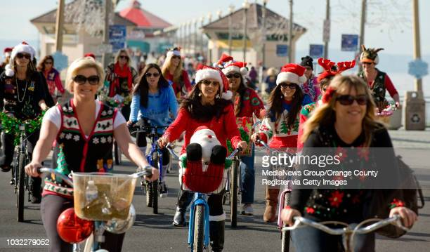 About 30 women ride their bikes across PCH from the Huntington Beach pier as part of the 2nd Annual Ugly Christmas Sweater Bike Ride ///ADDITIONAL...