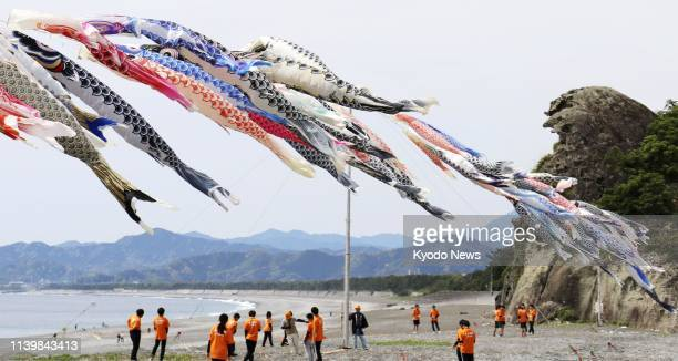 """About 300 """"koinobori"""" carp streamers fly over a beach in Kumano in Mie Prefecture, central Japan, on April 28, 2019. ==Kyodo"""