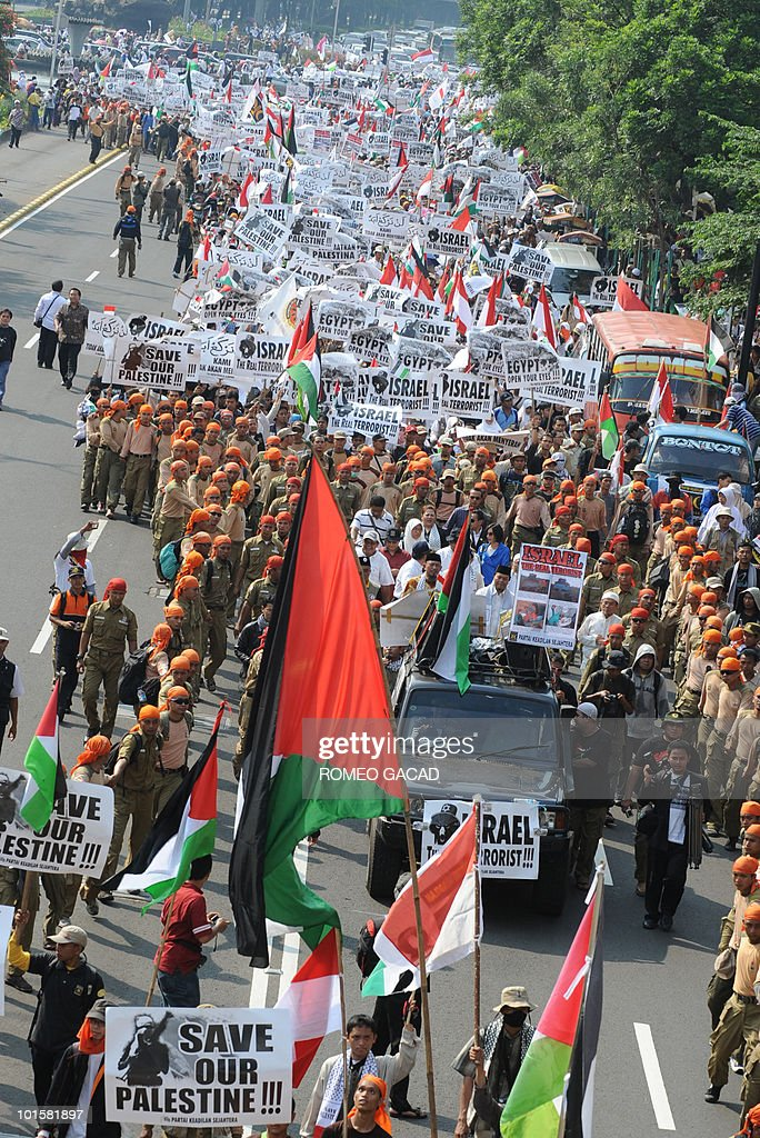 About 3,000 demonstrators belonging to Indonesia's Islam-based Prosperous and Justice Party carry flags and wave placards reading 'Israel the real terrorists' and 'save our Palestine' march in Jakarta on June 3, 2010 to condemn Israel's deadly raid on a Gaza-bound aid flotilla in which nine activists were killed and scores wounded. International pressure mounted on Israel to conduct independent inquiry into the bloody raid when Israeli commandos clashed with international activists as they attempted to turn back the aid flotilla in line with Israel's blockade of the Hamas-ruled Gaza Strip.