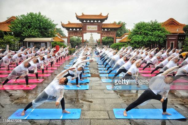 About 500 Chinese and Indian yoga enthusiasts practice Yoga at Yellow Crane Tower scenic spot ahead of International Day of Yoga on June 17, 2019 in...
