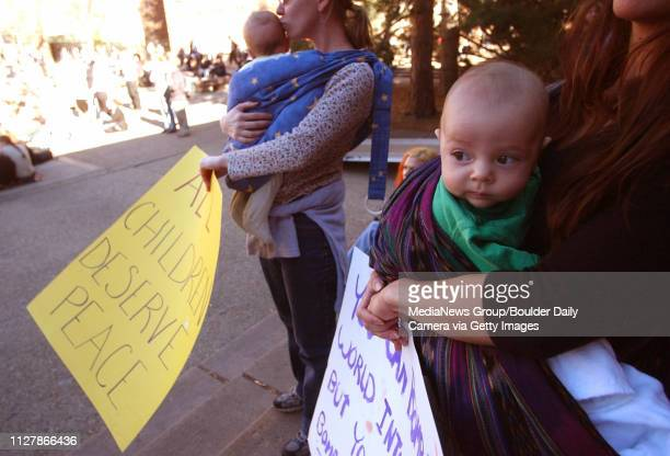 About 500 peace demonstrators held a rally at the Dalton Trumbo Fountain at the University of Colorado WednesdayFour month old Jackson Fries right is...