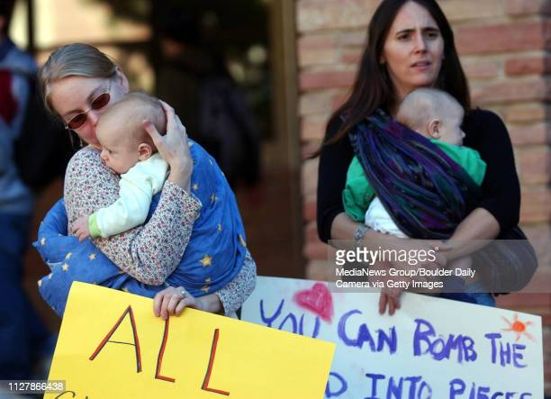 About 500 peace demonstrators held a rally at the Dalton Trumbo Fountain at the University of Colorado WednesdayKyle Mesrin left kisses her baby...