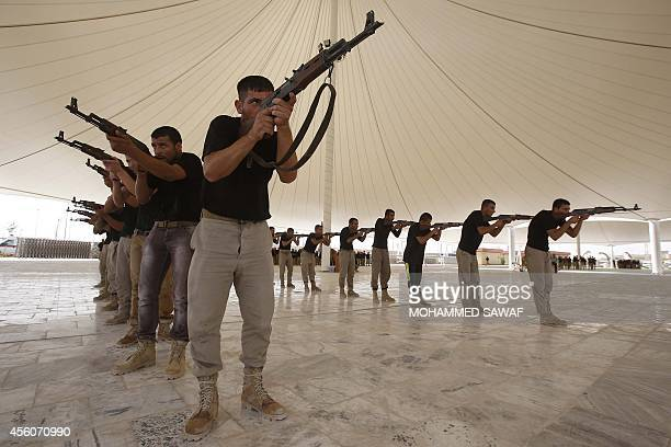 About 500 Shiite volunteers from Tal Afar attend a combat training session at a military camp in the Shiite shrine city of Karbala in central Iraq on...