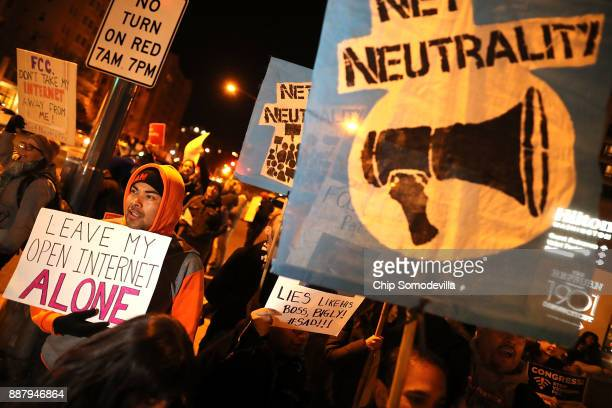 About 60 demonstrators gather outside of the 31st Annual Chairman's Dinner to show their support for net neutrality at the Washington Hilton December...