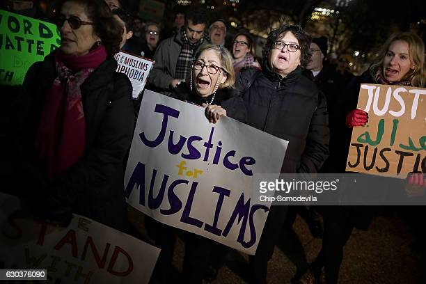 About 60 demonstrators gather outside the White House to protest the anti-Muslim policy proposals of President-elect Donald Trump and to stand 'with...