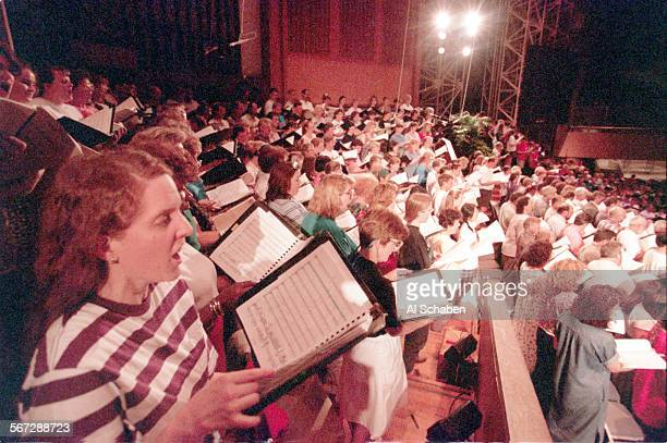 About 700 mixed choir and symphony members rehearse Monday evening for the Behemoth Mahler performance this weekend at the Crystal Cathedral. Bill...