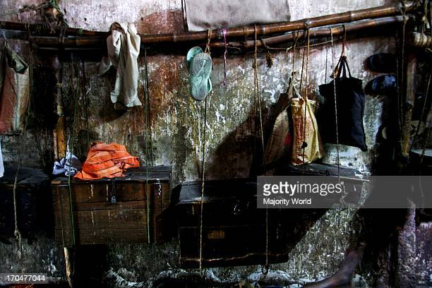 About 80 to 90 men share a 40 feet long room They sleep on the floor and hang their belongings on the wall Part of the photo feature Burning Iron...