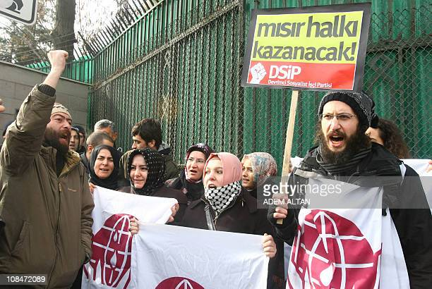 About a dozen members of a proIslamic humanrights group and a leftist party hold a joint protest on January 28 2011 in show of solidarity with...