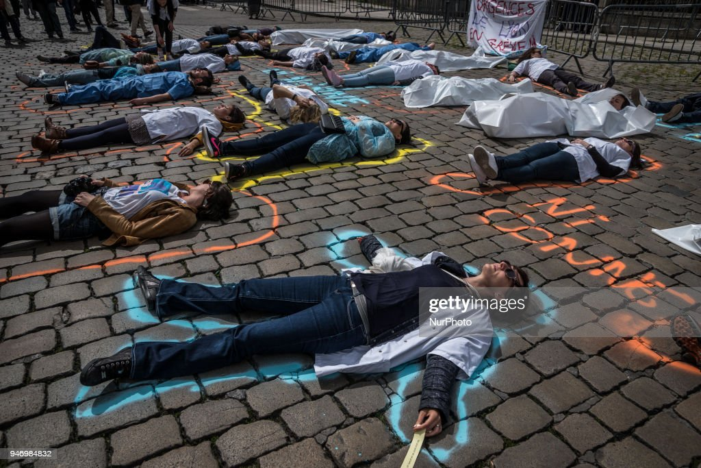 About fifty people, doctors, nurses and caregivers, demonstrated on April 16, 2018 on the Place de la Comedie in Lyon, France. Lying on the ground, the demonstrators made a Die-In denouncing their working conditions and asked for an appointment with the mayor of the city.
