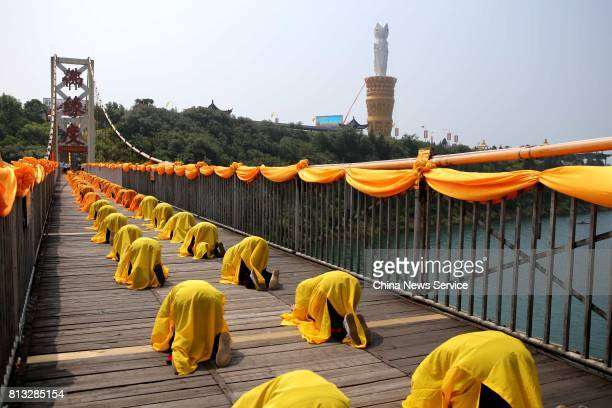 About one thousand Chinese monks move forward on a suspended bridge for blessing ceremony on July 12 2017 in Nanyang Henan Province of China The...