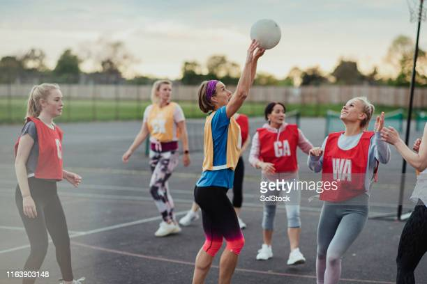 about to score a netball goal! - try scoring stock pictures, royalty-free photos & images