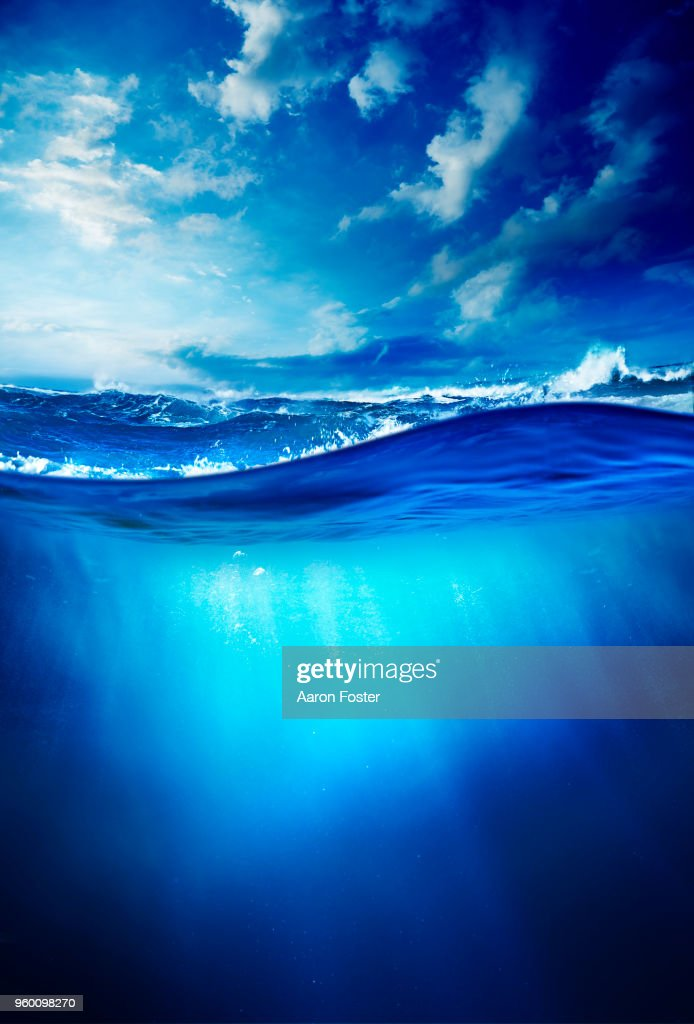 Above and below the waves : Stock-Foto