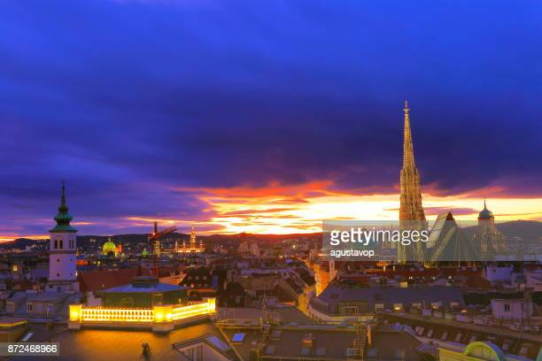 Above Beautiful Vienna Cityscape panorama, with St. Stephen's Cathedral, impressive building architecture and urban skyline at dramatic evening – Vienna , Austria