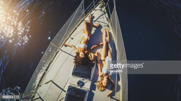Above friends together on a yacht sailboat