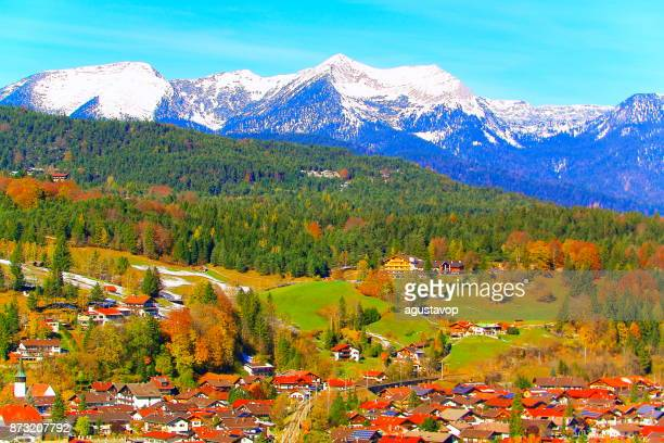 above mittenwald alpine village – dramatic landscape in bavarian alps in germany, near karwendel mountain range and border with austria - majestic alpine landscape in gold colored autumn, dramatic snowcapped mountains and lakes panorama - mittenwald stock pictures, royalty-free photos & images