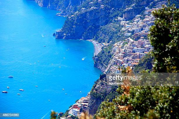 Above Positano panorama, ships and turquoise Amalfi Coast