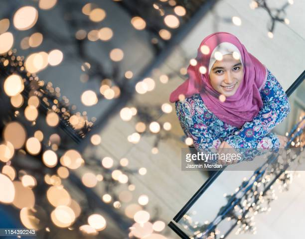 above shot of muslim girl - hijra stock pictures, royalty-free photos & images