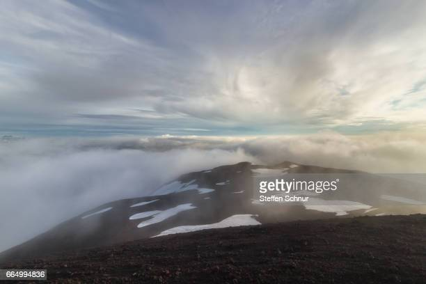 above the clouds on mountain Iceland vulcan sunset