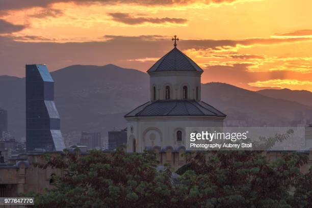 above the entrance to the holy trinity church tbilisi - トビリシ ストックフォトと画像