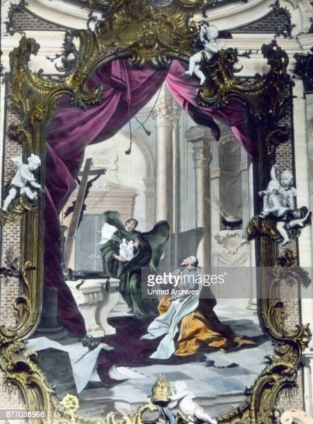 Above the entrance to the sanctum is a large painting depicting Emperor Ludwig of Bavaria as he kneels in front of an angel in human form from whose...