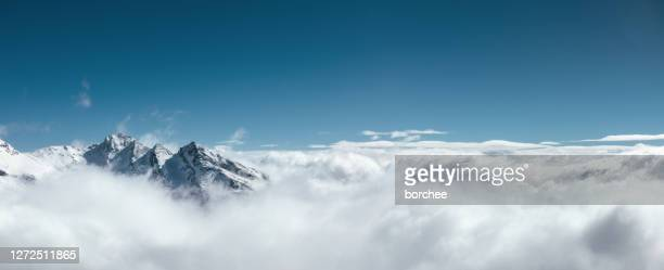 above the fog - mountain peak stock pictures, royalty-free photos & images