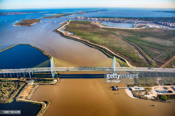above the fred hartman bridge in houston texas - gulf of mexico stock pictures, royalty-free photos & images