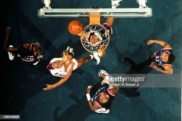 Above the hoop view of action during the American Basketball League All-Star game, Hartford, Connecticut, 1997. Among those pictured are Western...