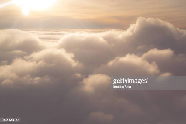 above the sliky smooth clouds view looking from airplane - 飛行機の視点 ストックフォトと画像