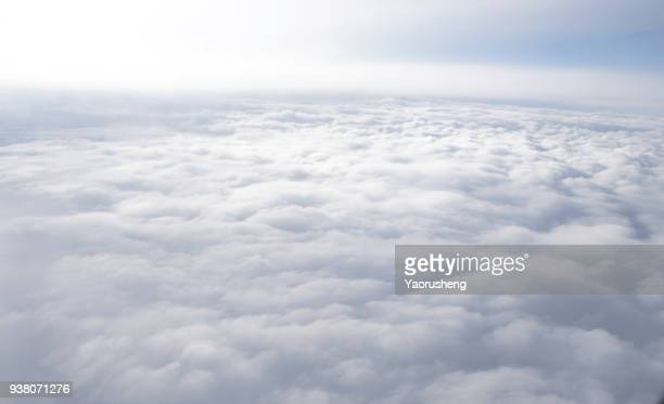 above the white cloud - cloudscape stock photos and pictures