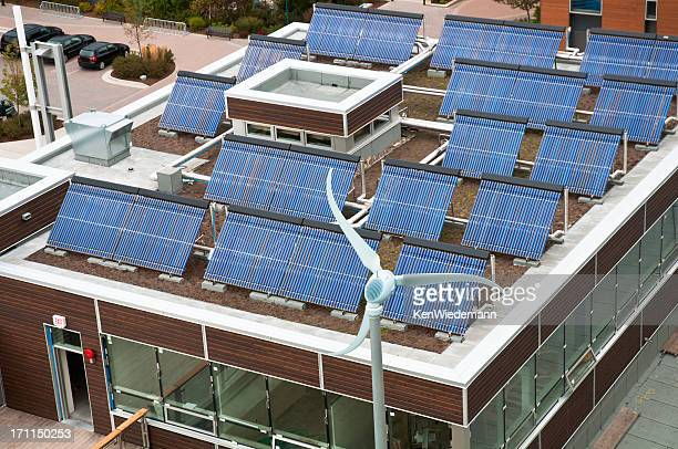Above view of a brown rectangle building with solar panels