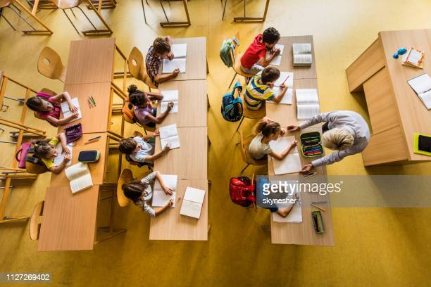 above view of a class at elementary school. - classroom stock pictures, royalty-free photos & images