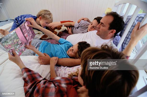 Above View of a Family Reading in Bed