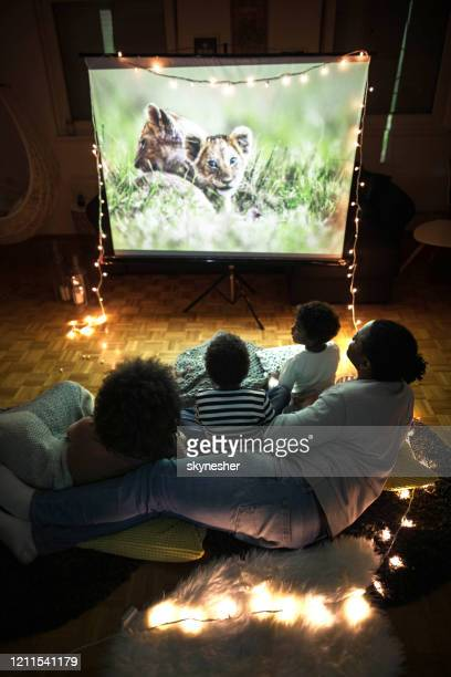 above view of a relaxed black family having a movie night at home. - watching stock pictures, royalty-free photos & images