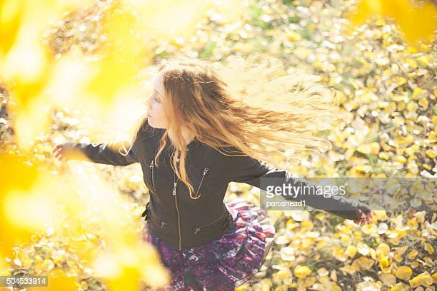 Above view of beautiful girl running in autumn park