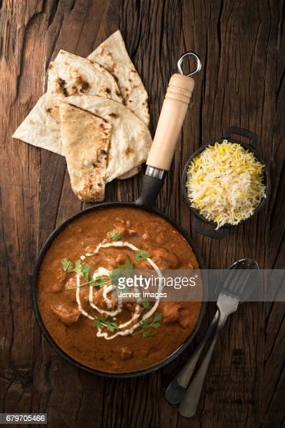 above view of butter chicken curry meal. - north indian food stock photos and pictures