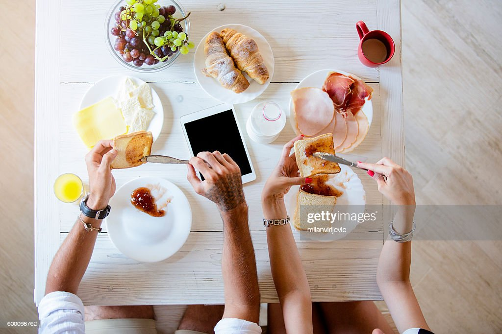 Above view of couple having breakfast : Stock Photo