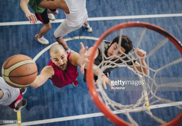 above view of determined basketball players in action. - net sports equipment stock pictures, royalty-free photos & images